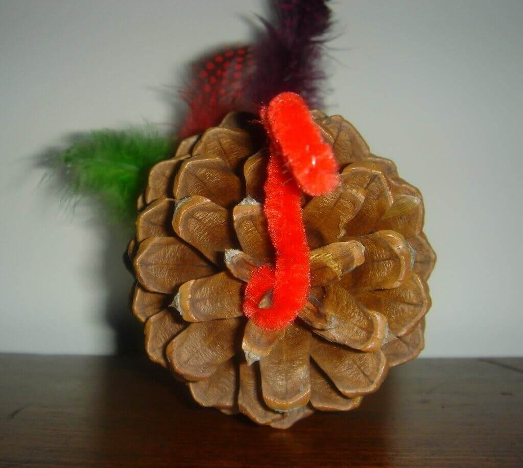 turkey made of pine cone and pipe cleaner