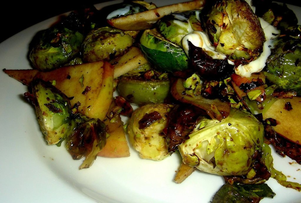 "Charred Brussels sprouts, sweet apples, sour crème fraîche and toasted pistachios combine to form a delicious mixture of contrasting flavors and textures in this ""Alta"" tapas recreation. A balsamic vinegar reduction offers an at once sweet and sharp bite. // alexandracooks.com"
