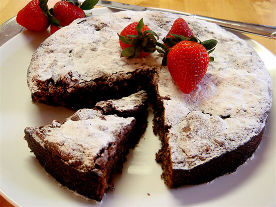 "This rich Passover chocolate cake rises dramatically, cracks and then falls. When dusted with Passover ""confectioners' sugar"" and garnished with berries, the cake looks striking on the table. // alexandracooks.com"