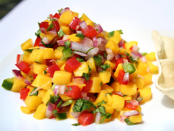 Flavored with traditional salsa seasonings — lime juice, cilantro and jalapeños — this mango pico de gallo makes a refreshing appetizer. Serve with pappadums for a nice change from tortilla chips. // alexandracooks.com