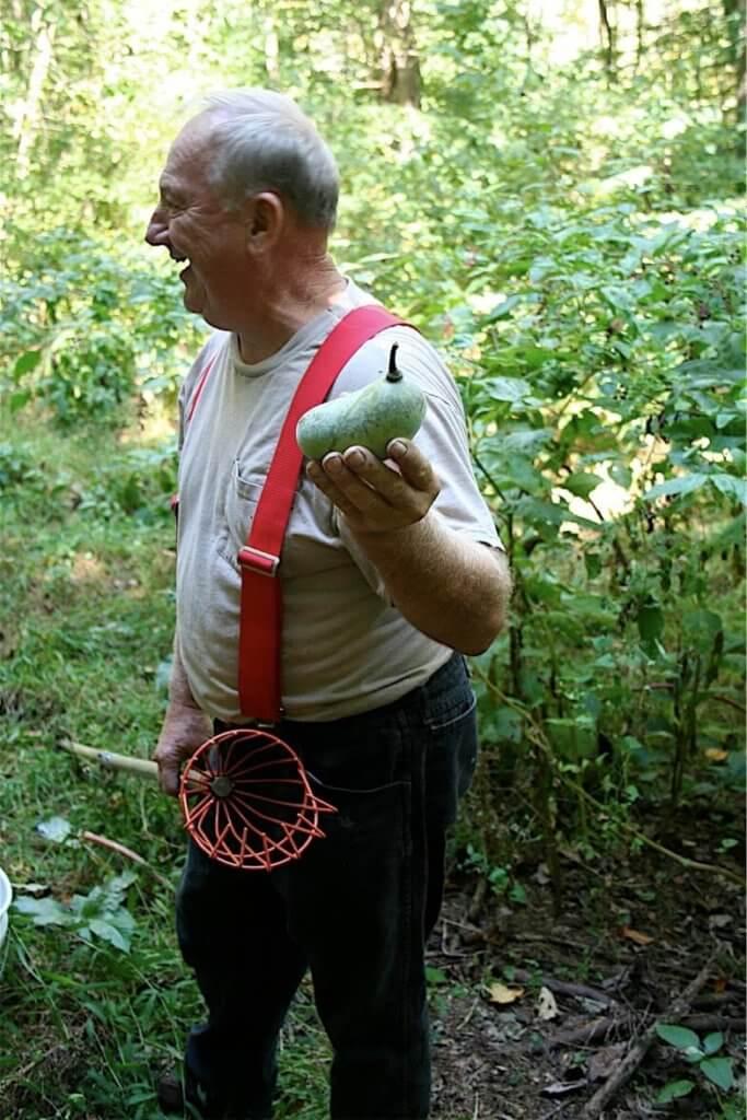 Sam Consylman holding a pawpaw.