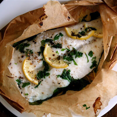 By keeping the fish piping hot, the fish en papillote method helps you eat more slowly, allowing you to savor your dinner, which I appreciate. // alexandracooks.com