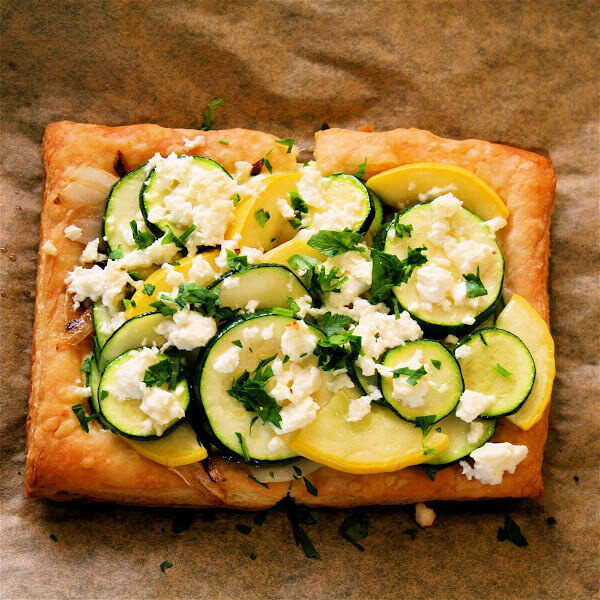Everything about this summer squash tart is great, from the ricotta-parsley spread to the caramelized onions to the blanched squash rounds to the barely melted feta crumbled on top at the last moments of baking. // alexandracooks.com