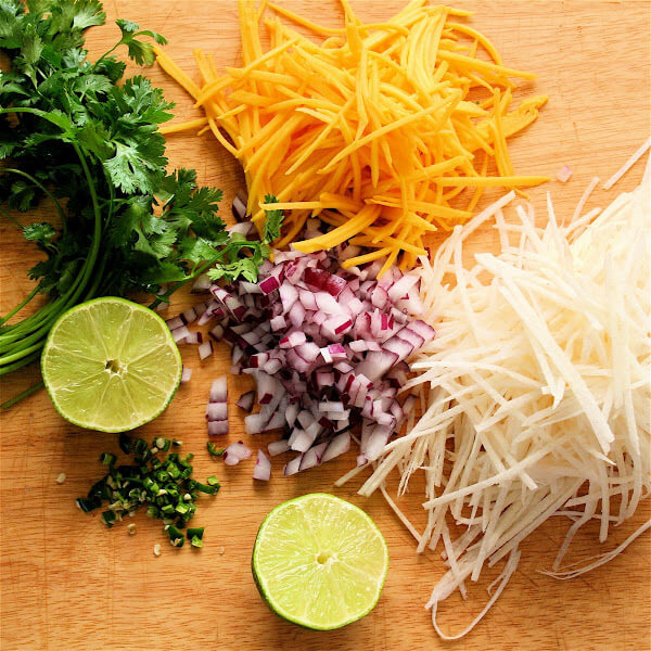Frozen halibut steaks fried up beautifully for these fish tacos, and once wrapped in the tortilla, spread with a dab of sriracha-sour cream and topped with this tasty slaw, the fish becomes a second-string player. // alexandracooks.com