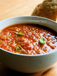 This roasted tomato soup has been made completely to taste. If you start with a base of slow roasted tomatoes, onions, garlic and shallots, I assure you your soup will be a success. Served with a few shavings of Parmigiano Reggiano and a piece of crusty bread, it makes a wonderful late summer meal. // alexandracooks.com