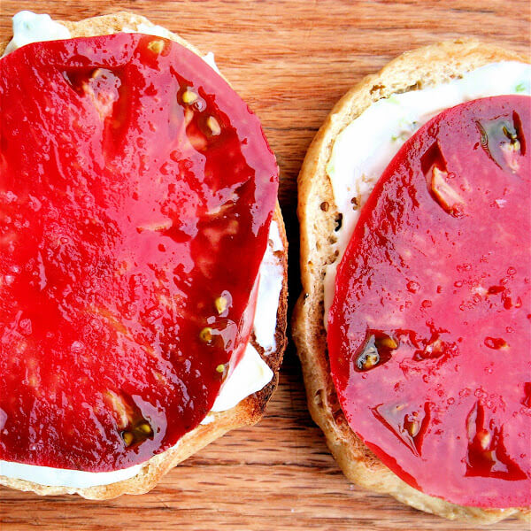 This has been my breakfast now for three days in a row: A toasted sesame bagel spread with chive cream cheese topped with a slice of tomato and sprinkled, of course, with sea salt. Amazing. // alexandracooks.com