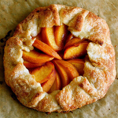 I love love love this peach tart recipe, especially the douch. I'm not quite sure how it differs from a traditional pie dough but it without fail produces a perfect crust. It also complements morning coffee very nicely as well. You won't be disappointed. // alexandracooks.com