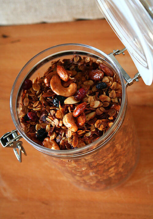 This homemade granola is delectable. The base recipe has been adapted from the Barefoot Contessa and the candied nut recipe comes from one of the Moosewood cookbooks. With the addition of dried cranberries and blueberries, this granola makes the best breakfast/snack/lunch/dinner ever. Seriously. // alexandracooks.com