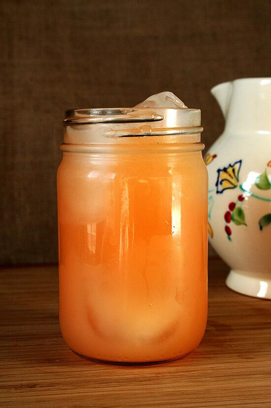 A ball jar filled with grapefruit soju cocktail.