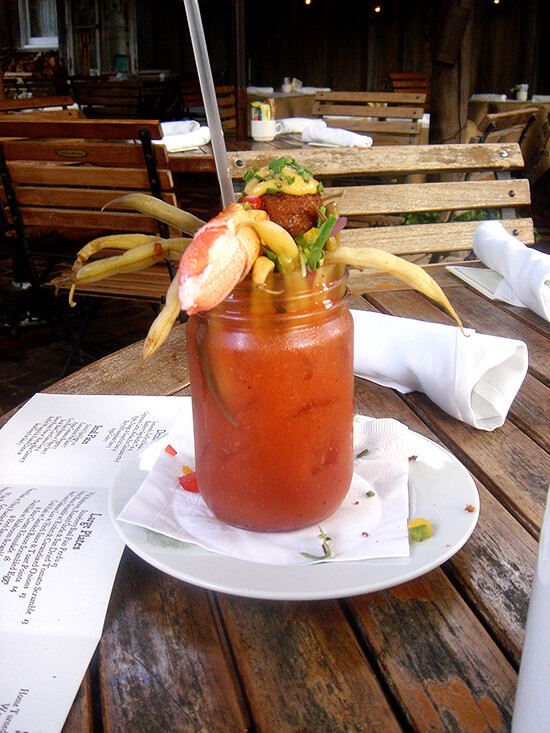 bloody mary with pickled green beans and a scotch quail egg