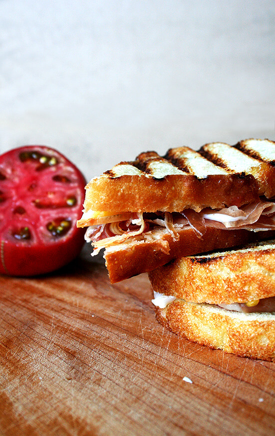 This sandwich, with toasted bread, rubbed with garlic, drizzled with olive oil, sprinkled with salt, moistened with a squeezed tomato and topped with jamón Iberico, is easily the most delicious sandwich on the face of the earth. // alexandracooks.com