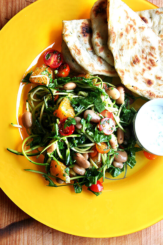 I have been wanting to incorporate more beans — such a healthy, affordable food, filled with protein — into my diet, and this salad has proven to be a great way to do so. I made this salad two nights in a row last week with my Alubia Criollo beans and other goodies from my CSA — arugula, cherry tomatoes, chives, shaved zucchini and chopped orange. // alexandracooks.com