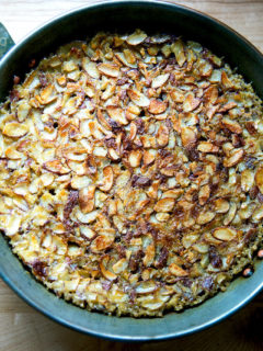 A bowl of freshly baked steel cut oatmeal with almonds.