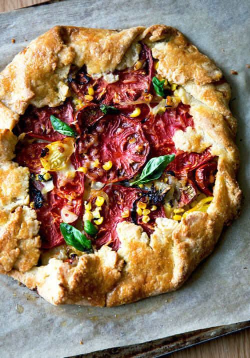 A freshly baked savory galette with corn, tomatoes, and gruyere.