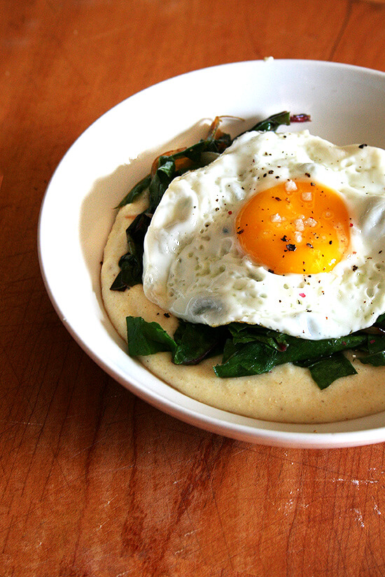 """This polenta without fear is delicious. Minimal stirring is required and the addition of a little water towards the end of the cooking process is all the doctoring necessary to produce """"creamy, soft, mouth-filling polenta,"""" as described on Bitten. // alexandracooks.com"""