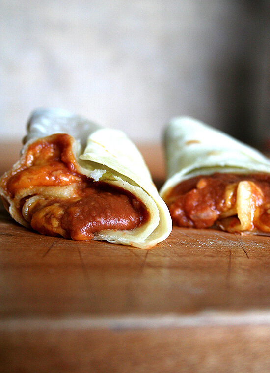 I now have a favorite beef taco recipe. The filling, a mixture of sautéed onions, tomato sauce, a little vinegar, a pinch of brown sugar and a homemade spice mix — cumin, coriander, chili powder and oregano — is a snap to make. We've been eating tacos once a week here. They are awesome. // alexandracooks.com