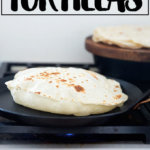 A homemade flour tortilla in a skillet.