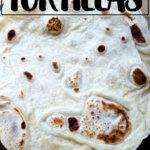 A homemade flour tortilla on a board.