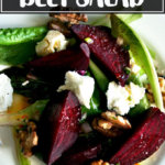 Salt-roasted beet salad on a plate with walnuts and goat cheese.