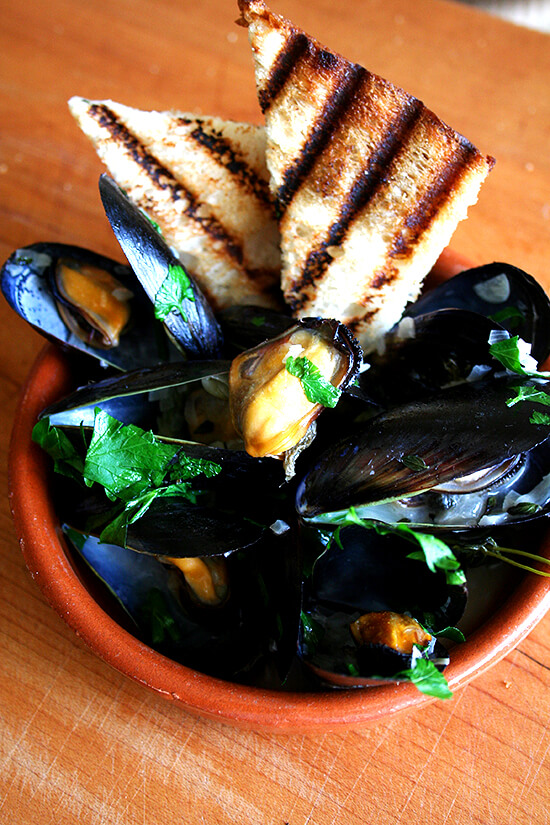 I think these moules mariniere would make a fun dish for entertaining.  The broth could certainly be made in advance, leaving you with no more than 3 minutes of cooking time. To complete this meal, all you need is some nice fresh bread, a simple salad, and some sort of lovely dessert. Yum. // alexandracooks.com