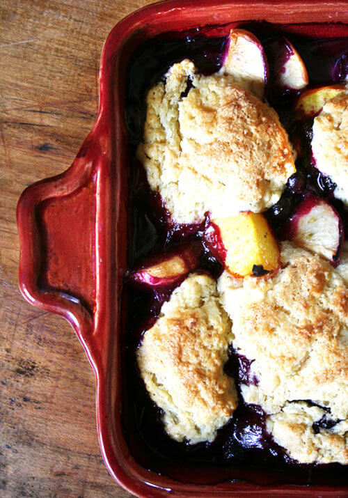 This peach blueberry cobbler is perfect for summer parties. With vanilla ice cream melting through each bite, smiles will abound. If you're needing to make a dessert for a crowd, look no further. This is it. Yum yum yum yum yum. // alexandracooks.com