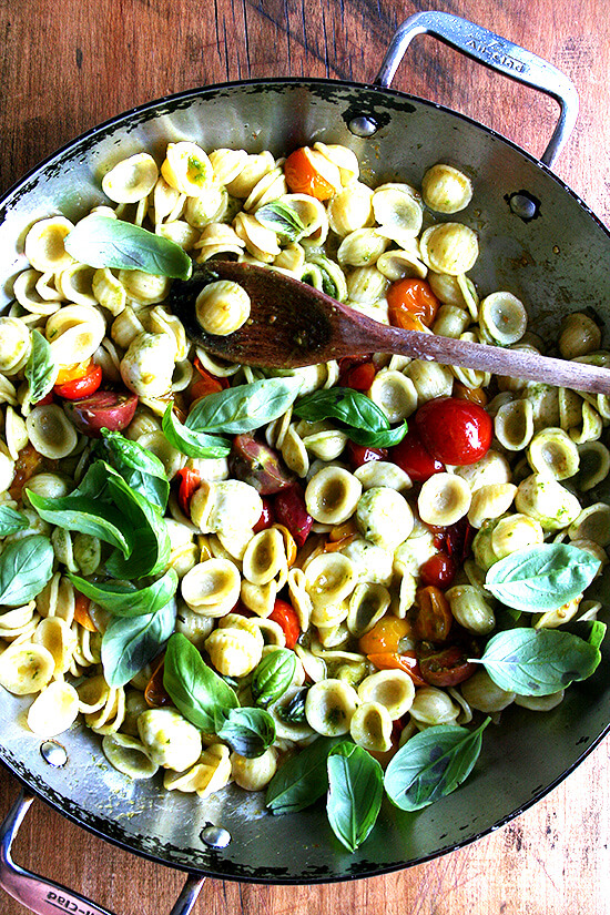 This summer pasta dish simple to prepare: Sauté cherry tomatoes with orecchiette, ciliegene mozzarella and basil pesto. Add some fresh basil just before plating along with some shavings of Parmigiano Reggiano and fresh cracked pepper. Yum yum yum. // alexandracooks.com