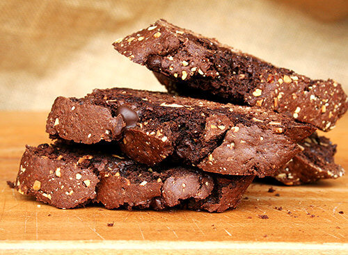 These chocolate biscotti are divine. Perfectly sweet. Not too hard. Crumbly. Soft. Not too soft. Loaded with chocolate and studded with almonds. A perfect accompaniment to a cup of coffee. I am convinced there is no better way to start the morning (and mid-morning and afternoon and early evening, etc.). // alexandracooks.com