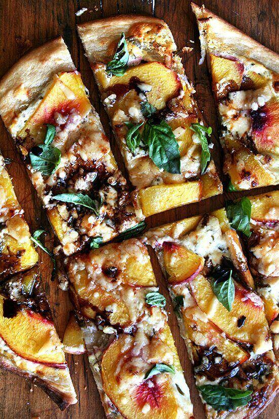 A nectarine pizza topped with blue cheese, basil, and reduced balsamic vinegar.