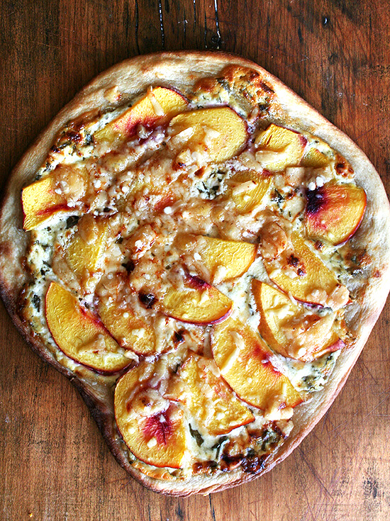 Just baked nectarine pizza on a board.