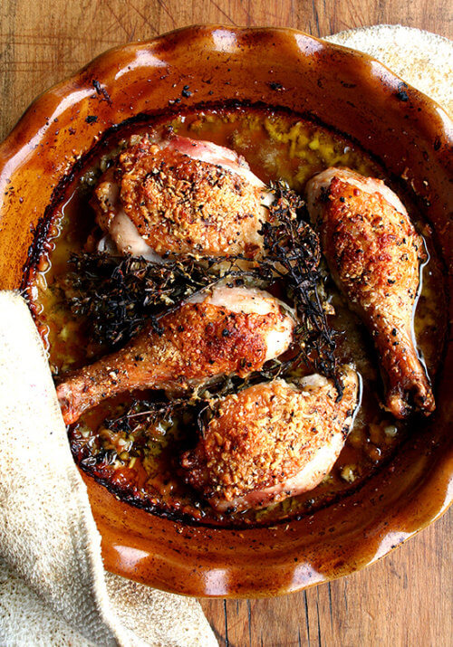 These chicken legs are simple: one-third cup olive oil, one-third cup white wine, one-third cup freshly grated Parmigiano Reggiano. Garlic and thyme are nice additions but optional. Just whisk everything together, season the chicken with salt and pepper, throw it in the oven and you're done. Crispy skins. Tender meat. A delicious meal to add to your repertoire. // alexandracooks.com