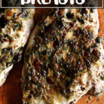 Broiled Tarragon Chicken Breasts on a board.