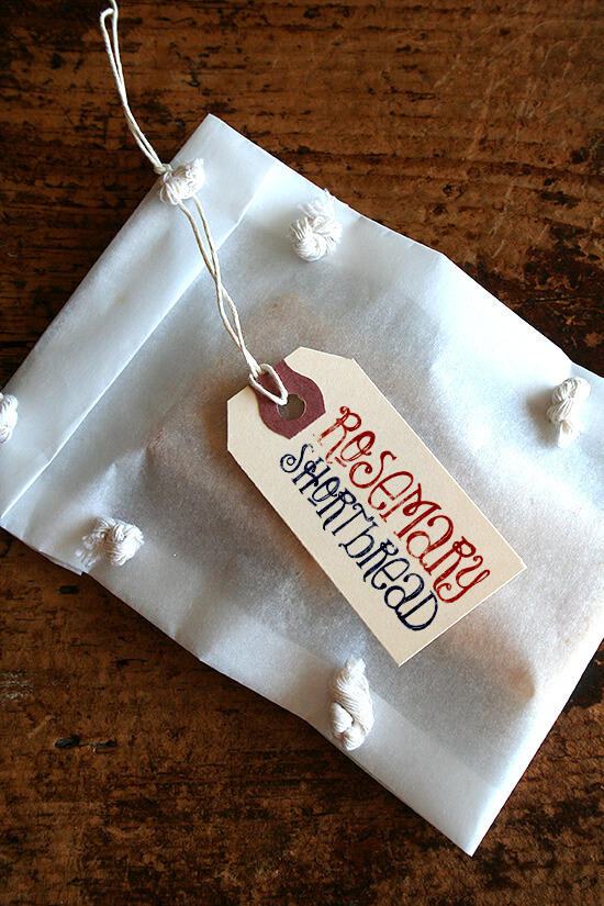 A package of rosemary shortbread with a decorative gift tag.