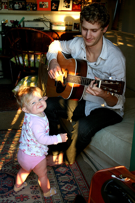 My brother playing guitar with Ella.