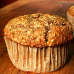 An oatmeal muffin on a board.