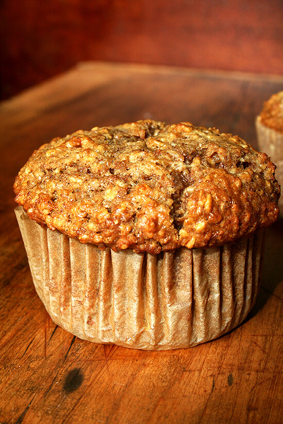 An oatmeal muffin on a board.