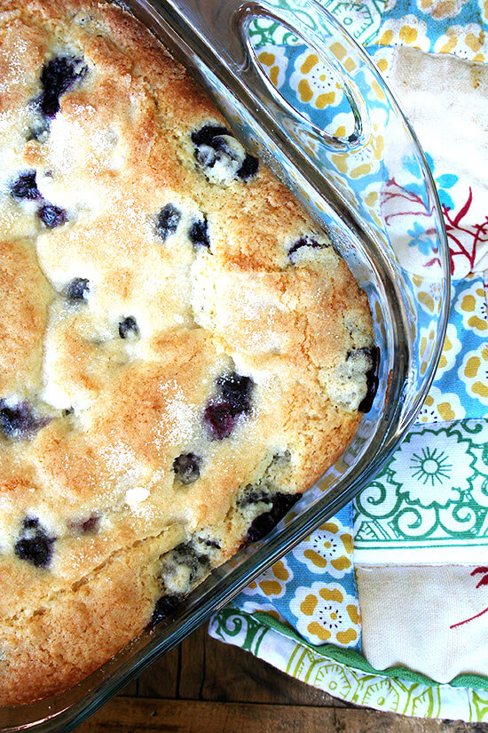 Overhead close-up of buttermilk blueberry breakfast cake in glass oven-safe baking dish