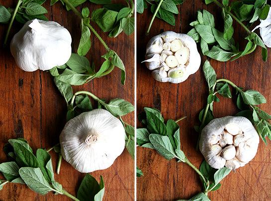 Garlic & Oregano on a board.