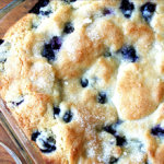 Lemon-blueberry buttermilk breakfast cake just baked in a glass pan.