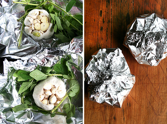 Foil Pouches filled with garlic heads and fresh oregano.