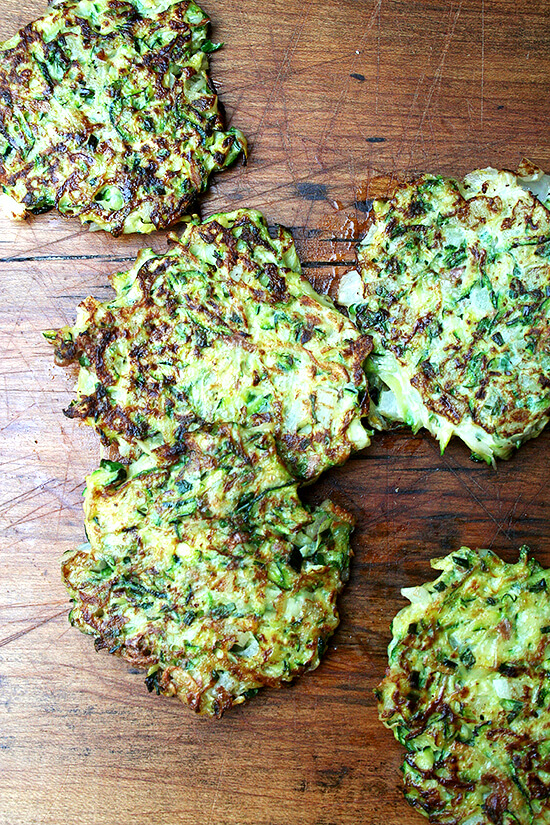 A combination of grated zucchini and potato with a little diced onion give these zucchini fritters a lovely latke texture. But the addition of lemon zest and lots of herbs give them a freshness and lightness that's irresistible. // alexandracooks.com