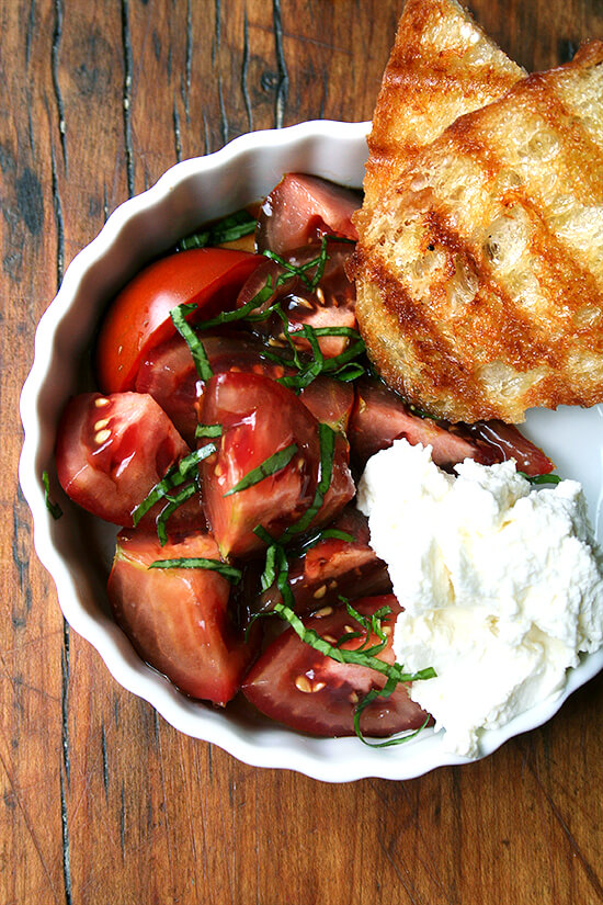 Could anything be more satisfying than this simple lunch this time of year? Homemade ricotta, Olin-Fox Farms CSA tomatoes, and grilled bread. Yum Yum Yum! // alexandracooks.com