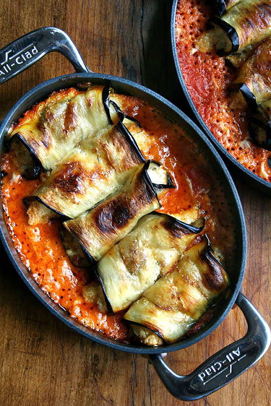 A most delicious, satisfying, vegetarian entree: eggplant involtini. In this Italian classic, ricotta-stuffed parcels bake with homemade tomato sauce and cream and garnished with fresh Parmesan, a perfect way to celebrate eggplant season! // alexandracooks.com