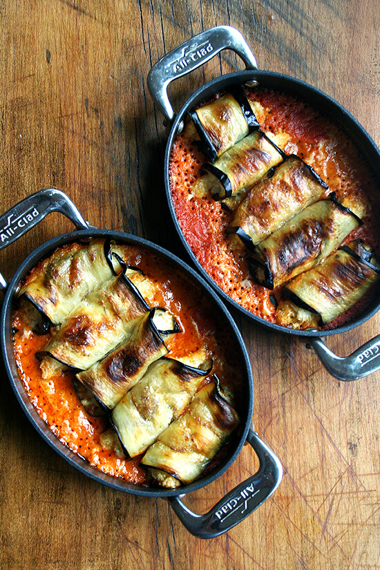 two pans of cooked eggplant involtini