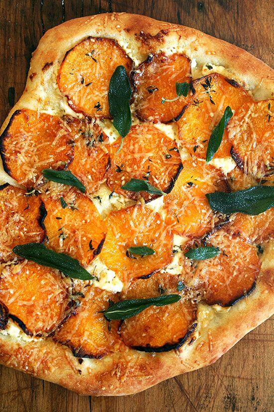 Garlic oil, homemade ricotta, roasted butternut squash, fresh thyme and crispy sage, this butternut squash and crispy sage pizza captures fall in every bite. What's more? The dough takes no more than five minutes to prepare. Happy fall! // alexandracooks.com