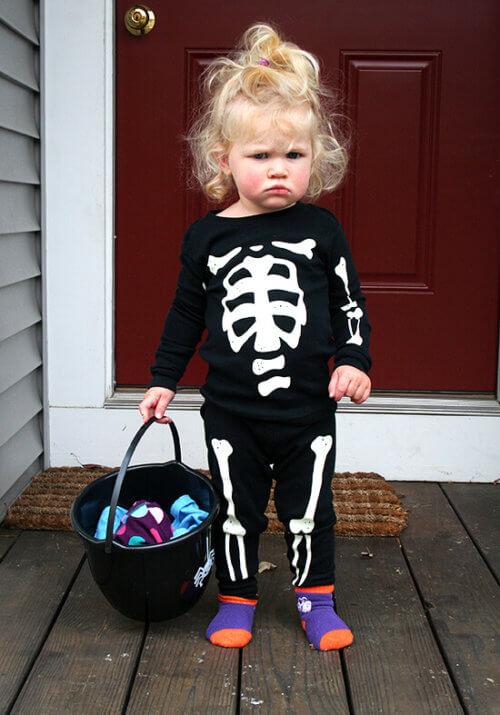 Ella, a one-year old, dressed in skeleton pjs.