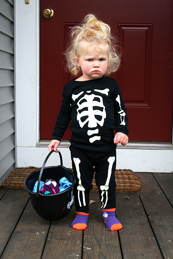 Ella, a one-year old, dressed in skeleton pjs.