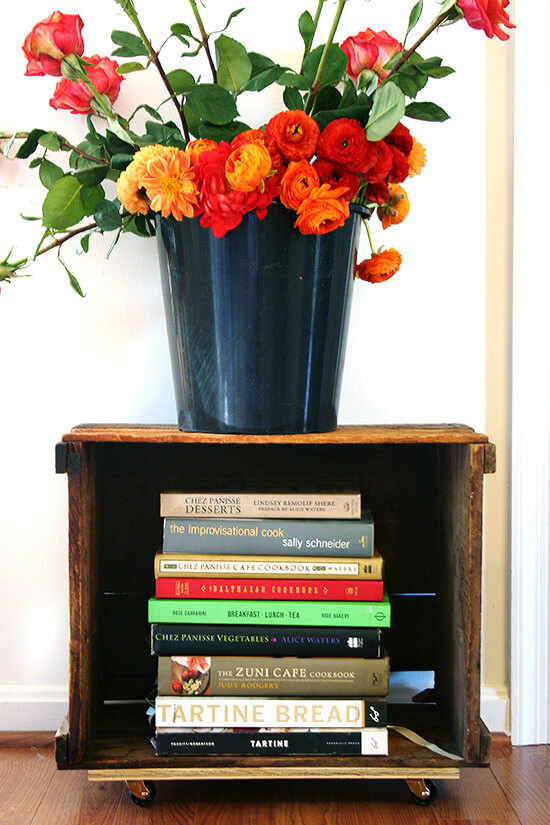 Looking for a purpose for old farm crates collecting dust in your basement? Try this farm crate bookshelf tutorial. It's not rocket science, will free up space in your home, and looks amazing! // alexandracooks.com