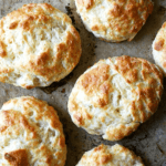 Tender and flaky, these buttermilk cheddar biscuits are the perfect vessel for housing slices of ham or turkey or roast beef, handfuls of arugula, and a slathering of mustard sauce, a must-have recipe if you're making ham this holiday season. // alexandracooks.com