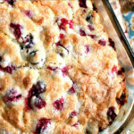 Just baked cranberry orange buttermilk breakfast cake in glass baking dish.