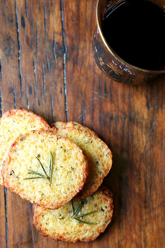These salty parmesan rosemary crackers beg to be washed down with a heartwarming libation, one made with red wine and port, a little something called glogg. Glogg is potent stuff — bone-warming, rosy-cheek inducing, party-starting stuff. It's a beautiful thing. Happy New Year everyone! // alexandracooks.com